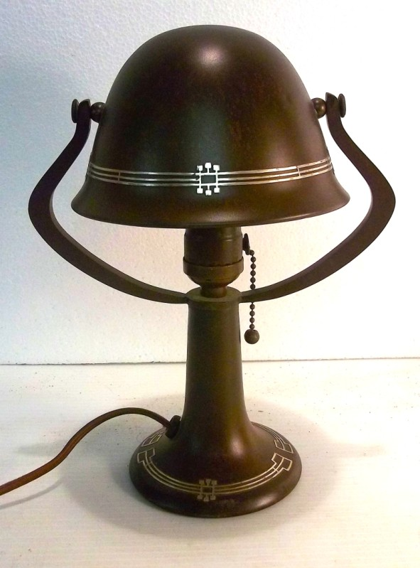 Ten-inch tall overall helmet lamp has geometric arts & crafts overlay ...